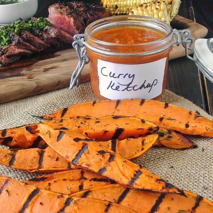 Sweet, herby, and smokey, these grilled sweet potato wedges get an added spice kick when dipped in curry ketchup. They taste as good as they look and don't take much time at all.