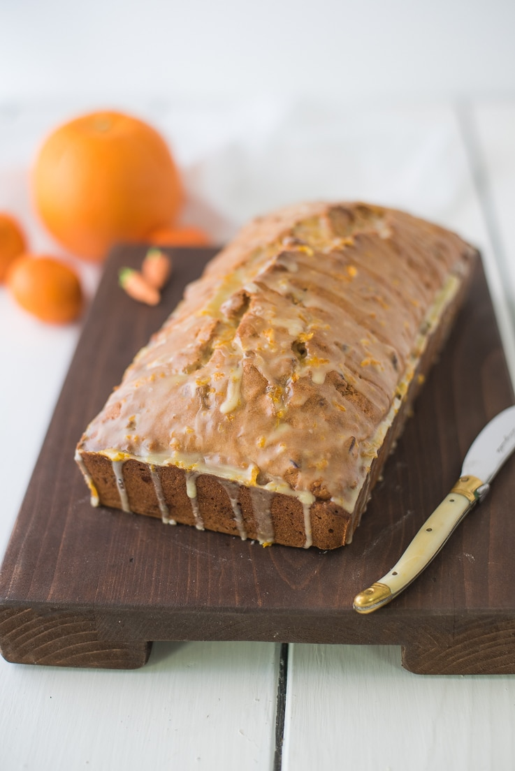 Carrot ginger spiced bread (done)-Carrot ginger spiced bread (done)-Carrot Ginger Spiced Bread with Orange Glaze with a knife ready to be sliced