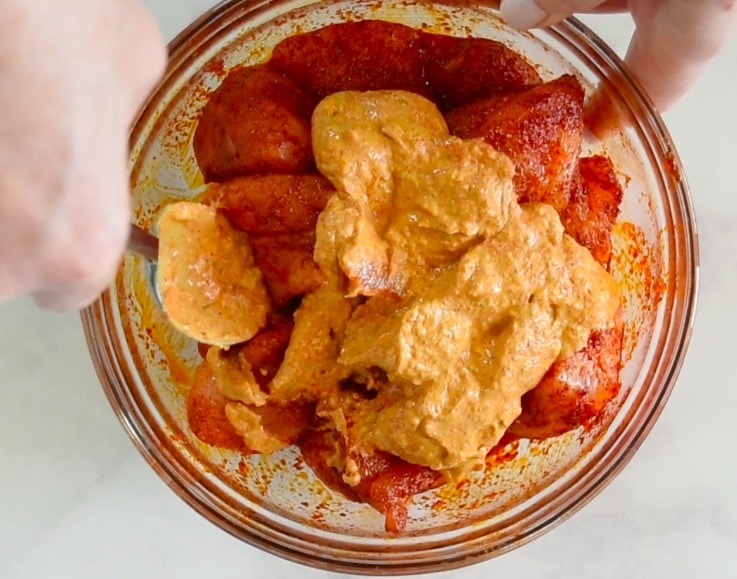 Marinade mixed with chicken pieces