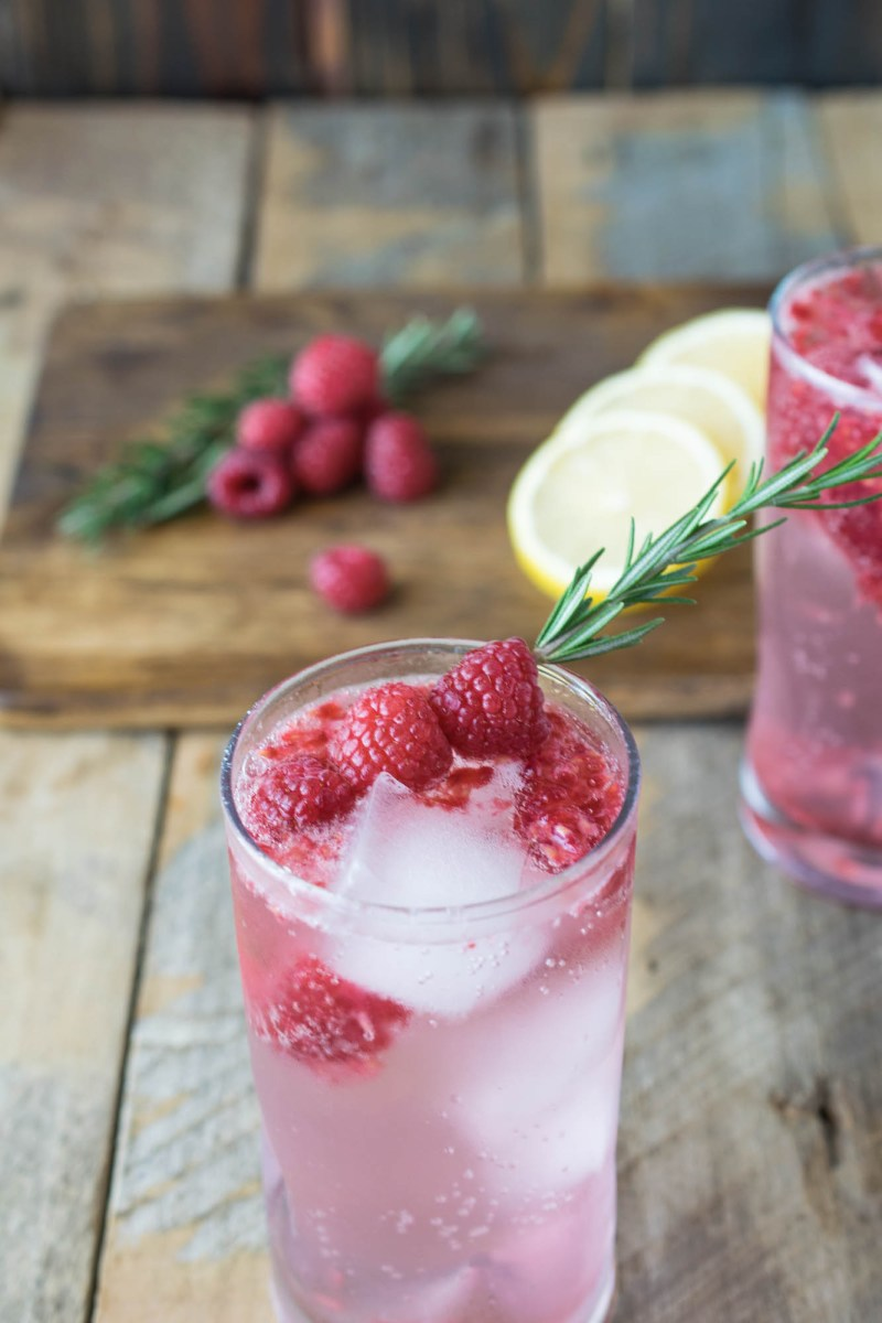 Raspberry rosemary spritzer is a fun mocktail that can be enjoyed all holiday season made with real ingredients. Fresh raspberries, rosemary and DASANI® sparkling berry.