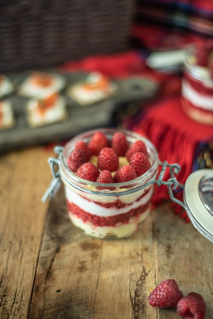 Scottish Raspberry Trifle Dip in a jar topped with fresh raspberries