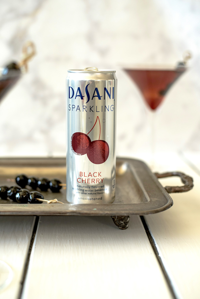 A sparkling Manhattan skyline cocktail is inspired by the classic Manhattan with a special addition of Dasani® black cherry sparkling. A delicious and refreshing drink for any time of the year and any occasion.