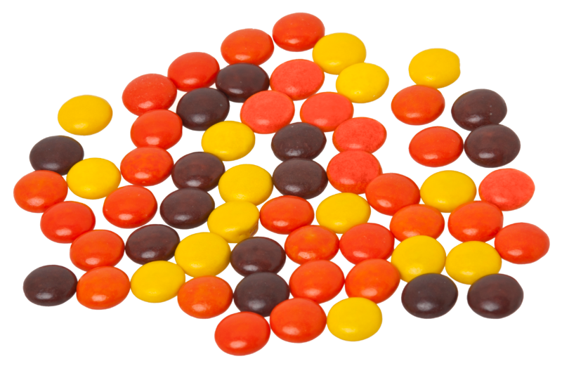 reeses pieces candy loose isolated on white