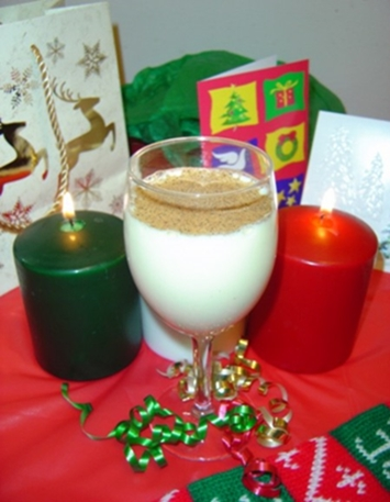 Christman eggnog with candles and cards