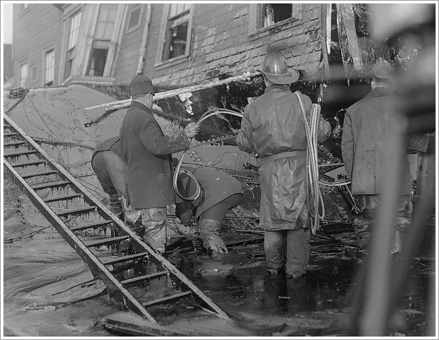 firemen standing in molasses after Boston Molasses flood