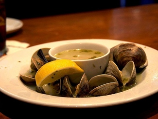 Dish of steamed clams with hot broth.