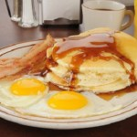 sunny side up eggs with pancakes and bacon