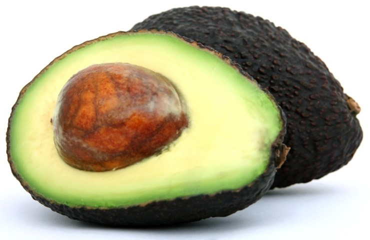Ripe Hass Avocado, whole and sliced