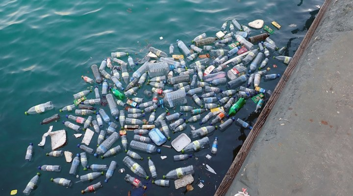 Plastic bottles and trash contaminating water