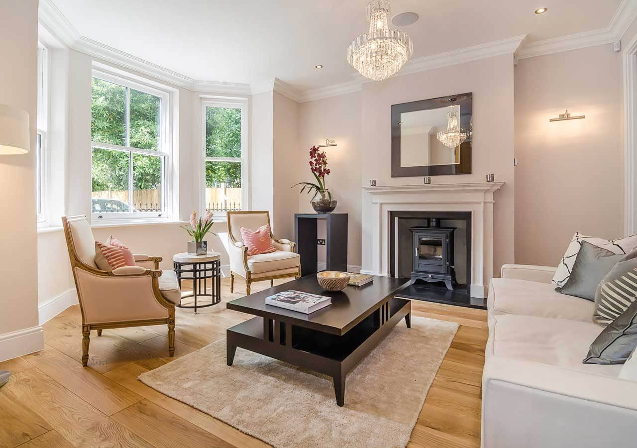 A classic contemporary reception room home staged by Cullum Design | London UK