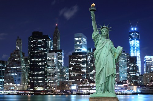 A photo of New York City, taken at night.
