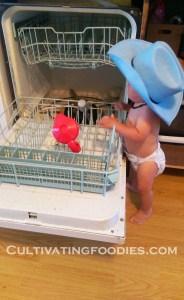 little chef loading dishwasher