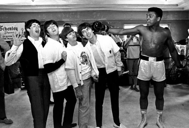 Appreciating Ali: FILE - In this Feb. 18, 1964, file photo, The Beatles, from left, Paul McCartney, John Lennon, Ringo Starr, and George Harrison, take a fake blow from Cassius Clay, who later changed his name to Muhammad Ali, while visiting the heavyweight contender at his training camp in Miami Beach, Fla. Ali turns 70 on Jan. 17, 2012. (AP Photo/File)