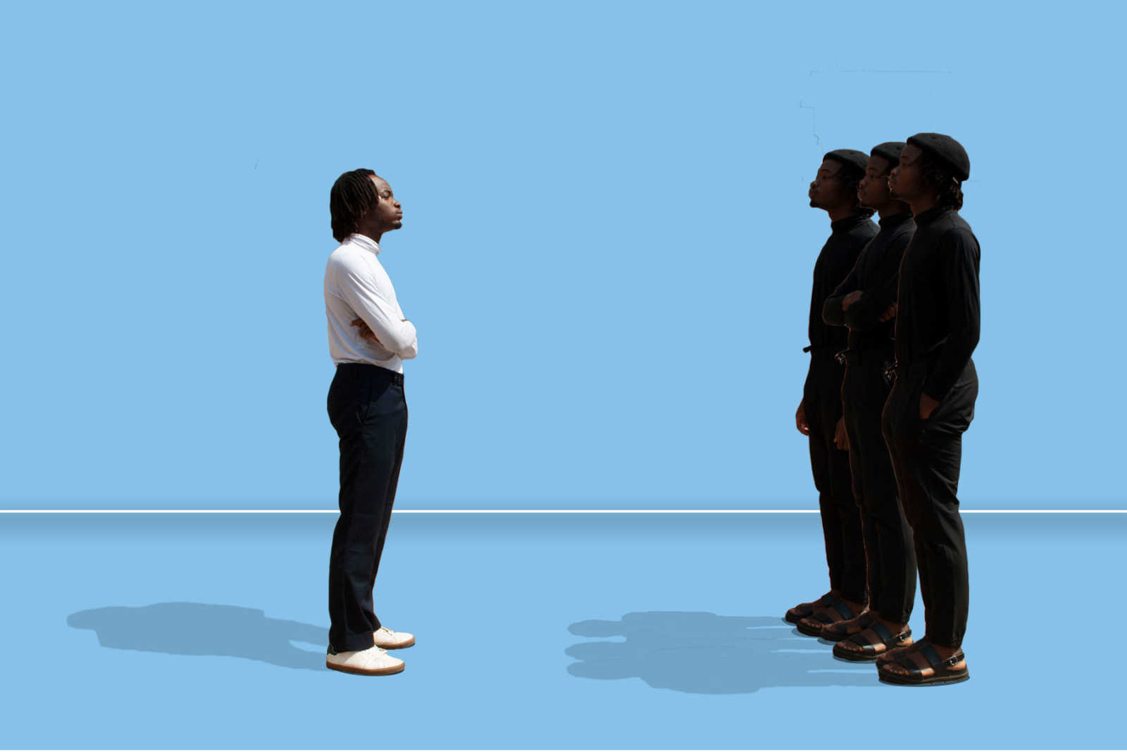 A Black man standing in front of a group of Black men