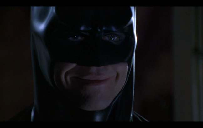 Val Kilmer smiling, as Batman