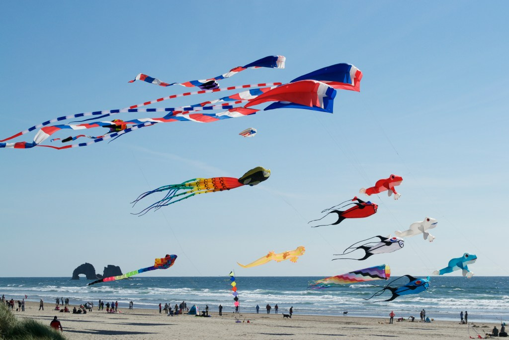 Flying kites on a windy day at Cannon Beach, Oregon