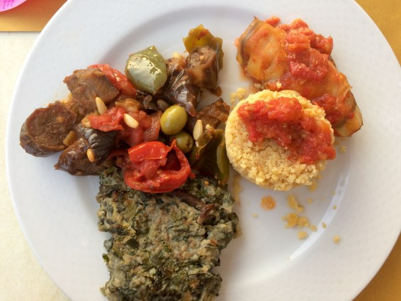 Cous Cous with tomato sauce, steamed vegetables and oven-baked greens.
