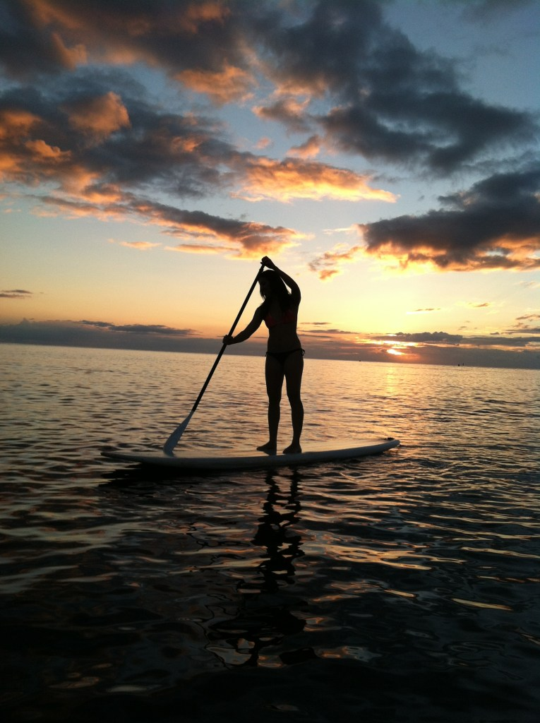 Stand up paddle boarding at sunset, Oahu Hawaii North Shore