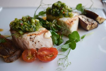 Marlin with pesto sauce and snap pea shoots