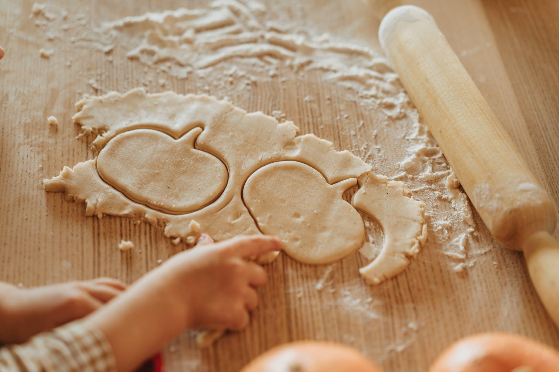 making pumpkin shaped cookies