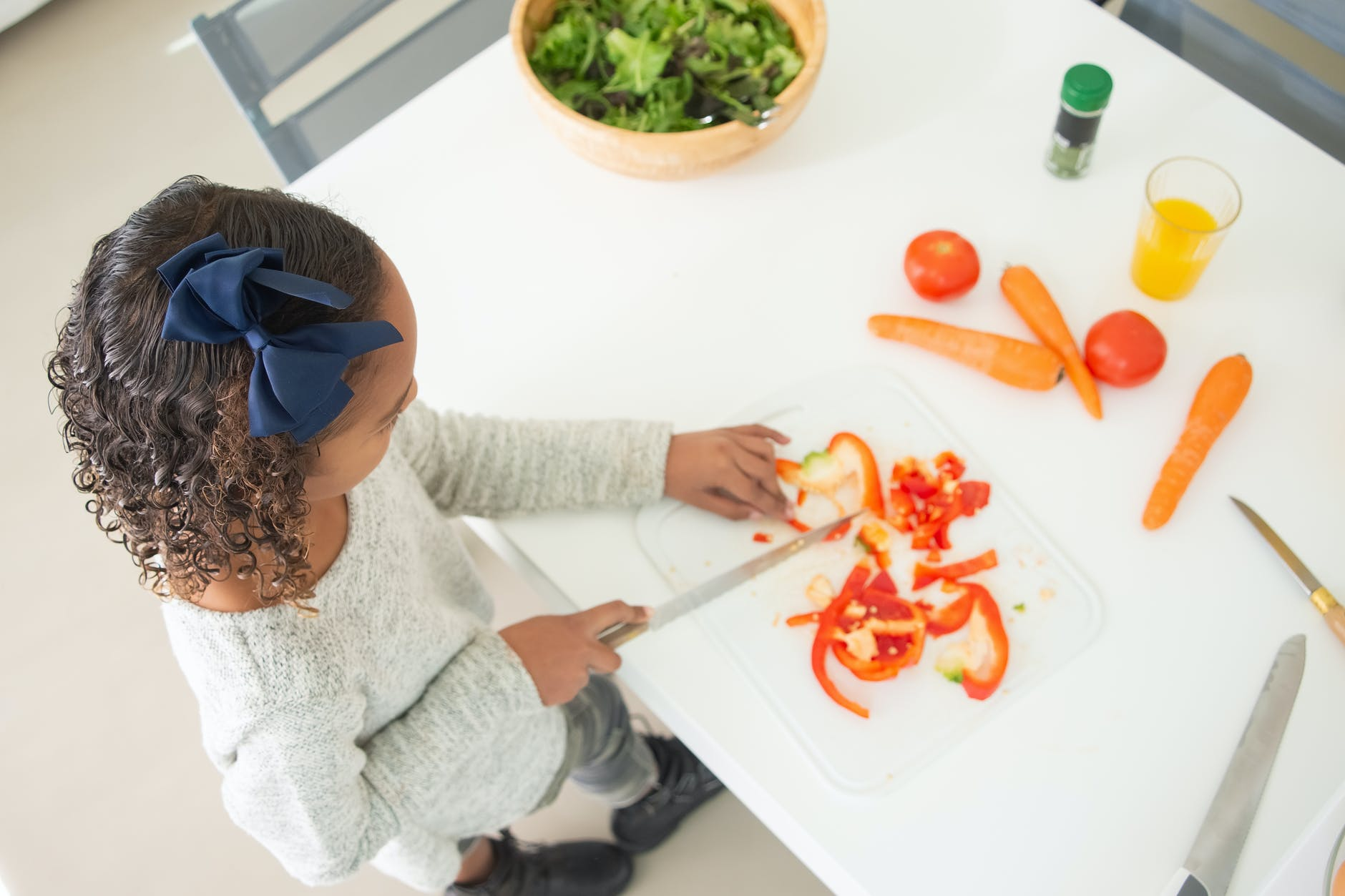 girl slicing bell peppers