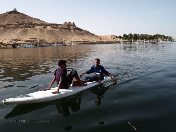 Children on surfboard, Felucca ride on the Nile