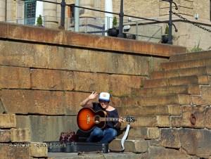 Man with guitar in Gothenburg, West Sweden