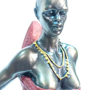 figurine, dinka lady with lamb, closeup