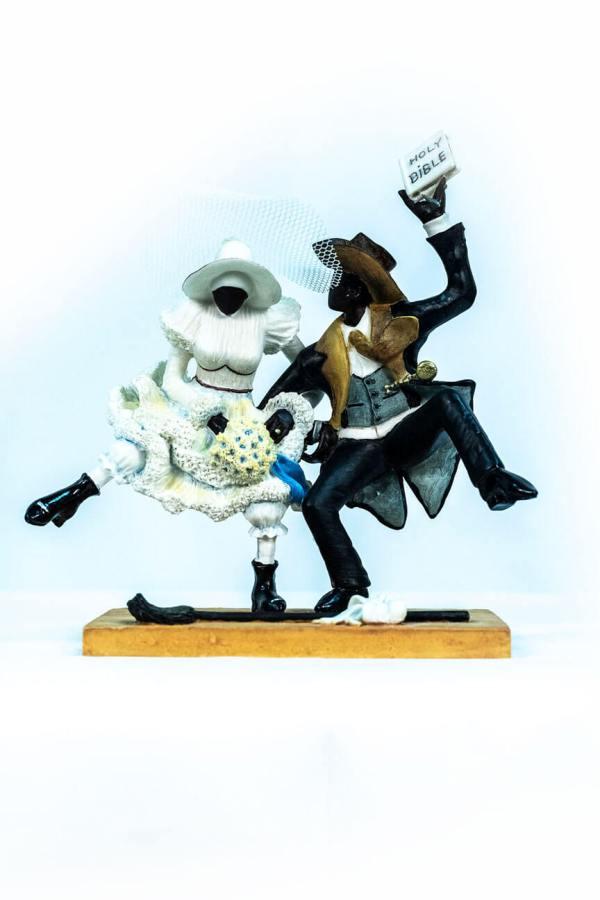wedding couple figurine, couple jumping broom, front