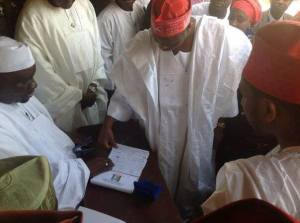 Governor Rabiu Kwankwaso of Kano State registers amidst his supporters.