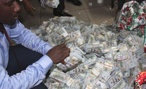 efcc man counting money and sweating