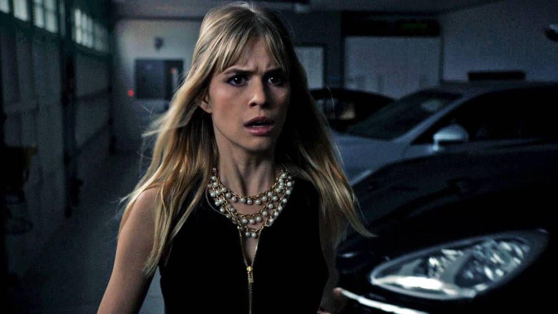 Carlson Young as Brooke, the show's mean girl