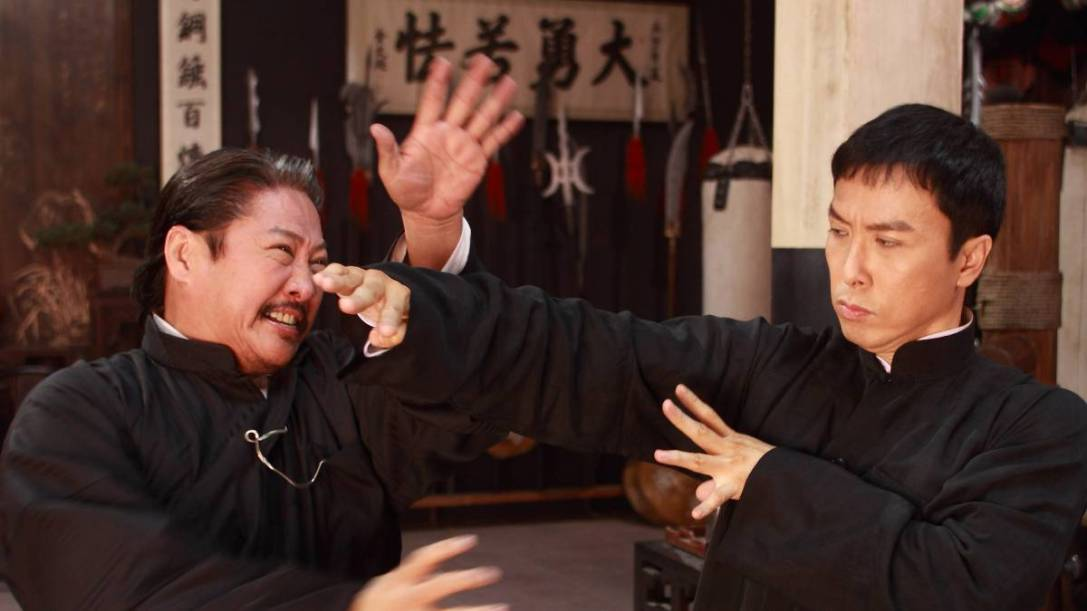 A screenshot from Ip Man 2, showing Donnie Yen engaged in a fight with Sammo Hung.