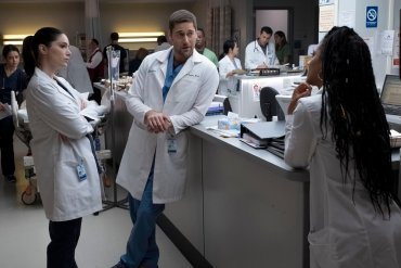 """NEW AMSTERDAM -- """"Anima Sola"""" Episode 112 -- Pictured: (l-r) Janet Montgomery as Dr. Lauren Bloom, Ryan Eggold as Dr. Max Goodwin, Freema Agyeman as Dr. Helen Sharpe -- (Photo by: Francisco Roman/NBC)"""