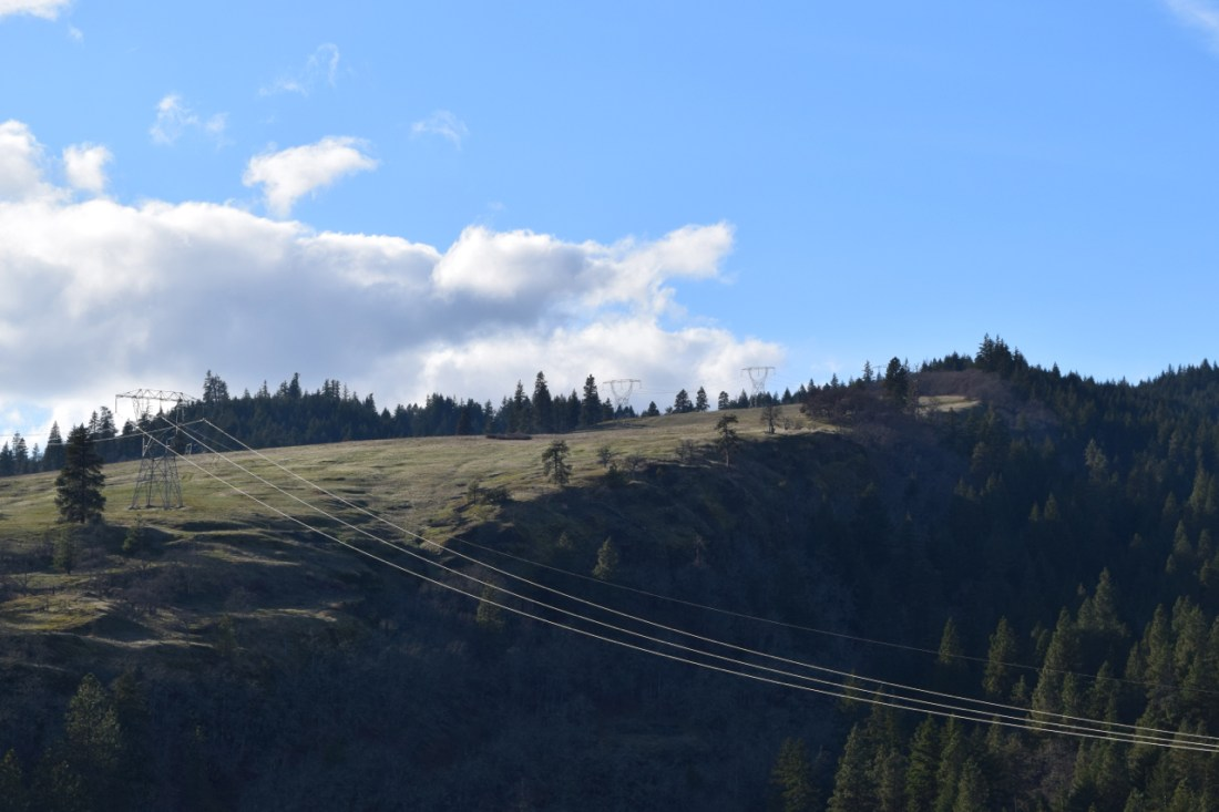 Photograph of powerlines hung across a valley