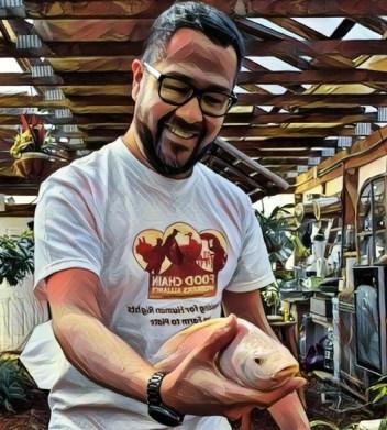 Jose Oliva holding a fish