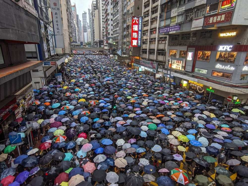 Aerial picture of thousands of different colored umbrellas in the streets of Hong Kong