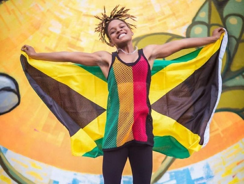 Crossover artist Koffee repping Jamaica