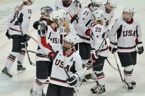 Women's Hockey team in white uniforms at the 2010 Winter Olympics.