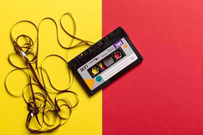 類比音樂(Analogy)與數位音樂(Digital)// 卡式帶 //black cassette tape on top of red and yellow surface