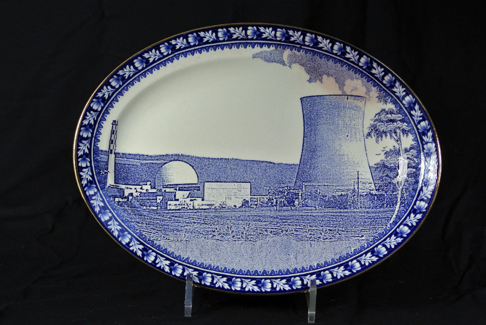 Inglaze decal collage and gold lustre on old earthenware plate (c.1930) marked marked Reliable, Phoenix, Burslem. 30cm x 22.5cm