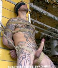 inked man blindfolded erect