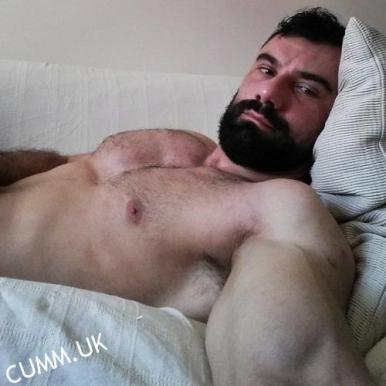 wanking to porn in bed