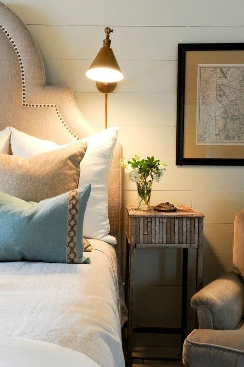 casual beachy bedroom with reading lamp