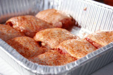 The Chicken thighs after they are trimmed and rubbed.