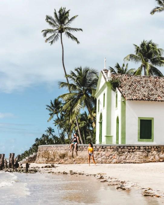 Church on the beach Brazil | Guide to Maragogi vs Porto de Galinhas alternative, Brazil | Praia dos Carneiros tour review travel couple