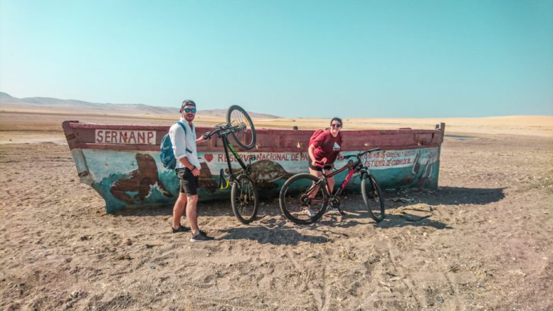 biking in Paracas national reserve on bikes desert in Peru travel guide languilla