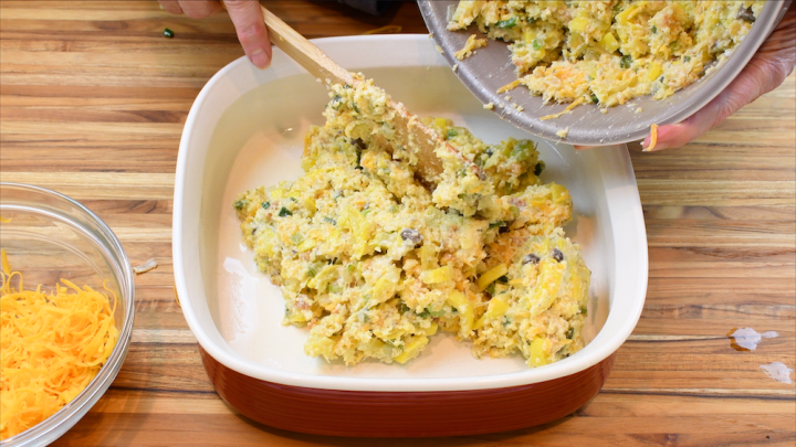 adding blended squash casserole to the baking dish