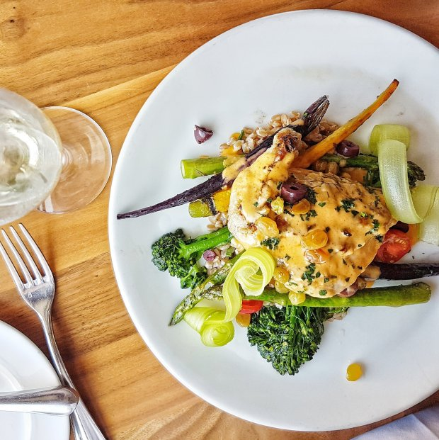 Chicken Confit on a bed of creamy farro was divine by Chef Dana Francisco at La Valencia Hotel in La Jolla.