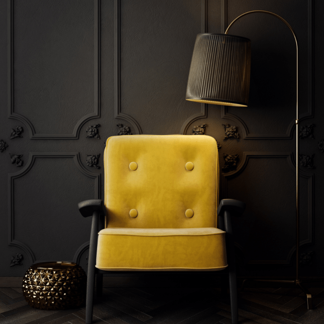 Yellow armchair showing contrast of brightness against dark wall